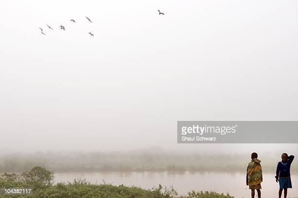 Daily life seen as children walk by a river April 18 2008 in Rwanda