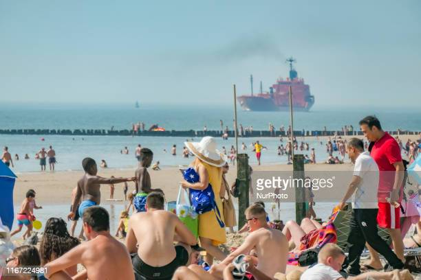 Daily life with people enjoying the summer sun at Vlissingen beach in Zeeland, The Netherlands on 25 August 2019. The 4-kilometer long beach has...
