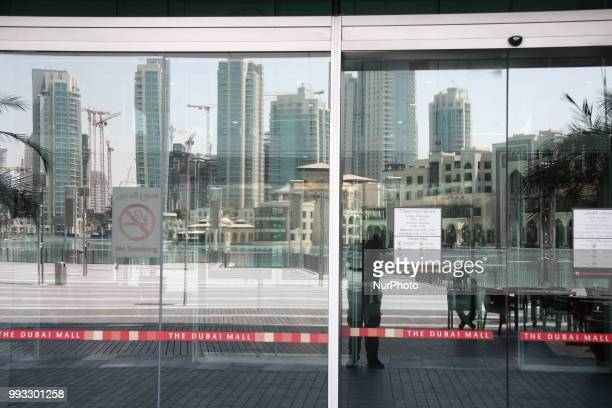 Daily life with the construction of many high buildings as seen in August of 2011 in Dubai UAE Among the buildings is the talest in the world Burj Al...