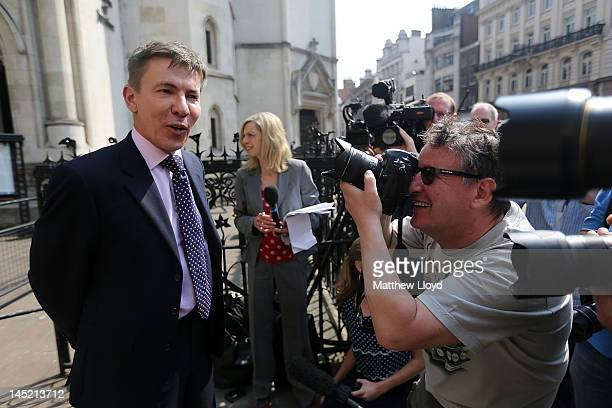 Daily Mail journalist Andrew Pierce makes a statement to the press outside the High Court after Carina Trimingham partner of the former Energy...