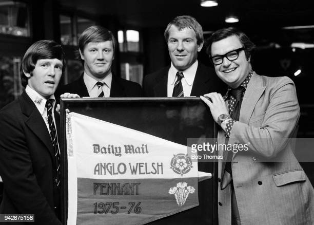 Daily Mail sports editor Tom Clarke presenting the AngloWelsh pennant to representatives of the Northampton Saints rugby team Ian Wright Andy Johnson...