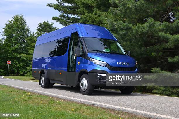 IVECO Daily minibus driving on the street