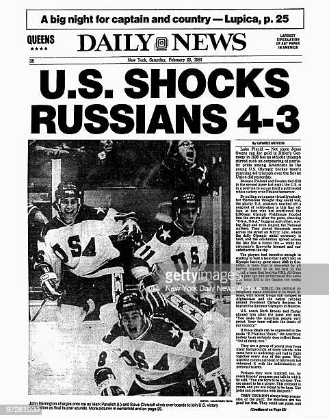 Daily News back page dated Feb 23 Headline US SHOCKS RUSSIANS 43 John Harrington charges onto ice as Mark Pavelich and Steve Christoff climb over...