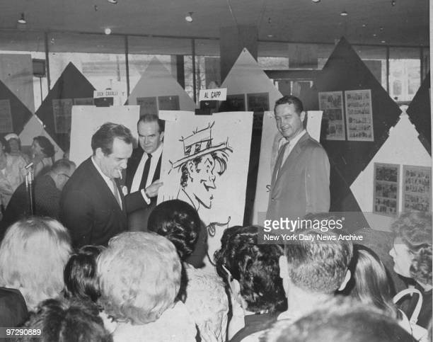Daily News cartoonist Al Capp draws his comic character, L'il Abner, for World's Fair visitors.