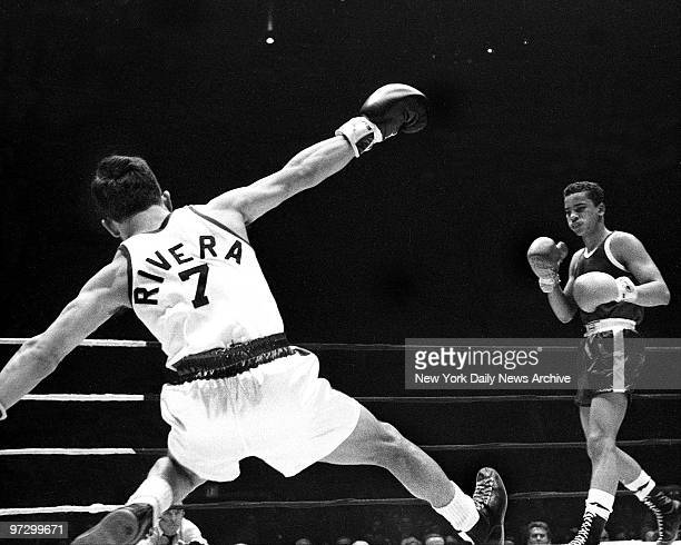 Daily News Golden Gloves at Madison Square Garden Israel Rivera heads for canvas during 112pound Open bout His opponent Eduardo Santiago copped crown
