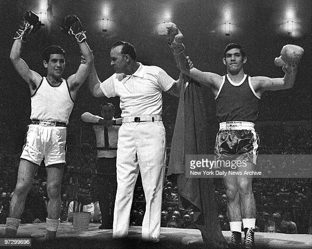 Daily News Golden Gloves at Madison Square Garden Jose and Vilomar Fernandes have their arms raised by ref after being named cochamps in 126pound...