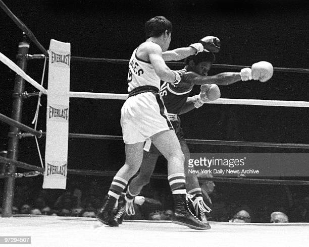 Daily News Golden Gloves Finals at Madison Square Garden Victor Morales throws left and met by Richard Harris' right in second round of 112 SubNovice...