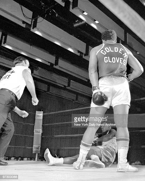 Daily News Golden Gloves heavyweight Manny Robles stands over his fallen opponent Rodell Dupree after delivering a KO punch at 214 of second round in...