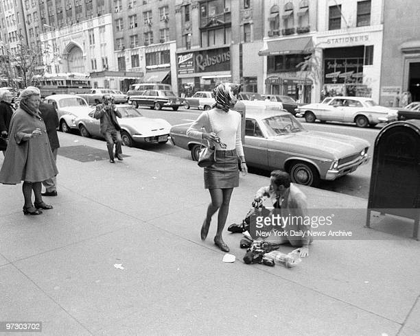 Daily News photographer Mel Finkelstein and equipment go flying after Jacqueline Kennedy Onassis flipped him with judo hold as Mel took her picture...