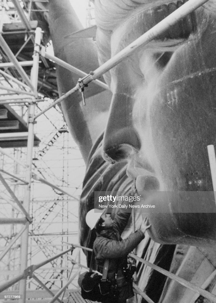 years since the dedication of the statue of liberty photos and  n y daily news staff photographer thomas monaster on scaffolding that surounded the the statue of