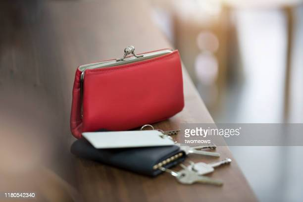 daily objects women's purse, keys in pouch and security access cards. - metallic purse stock pictures, royalty-free photos & images
