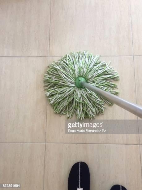Daily perspective: Low section woman scrubbing the floor