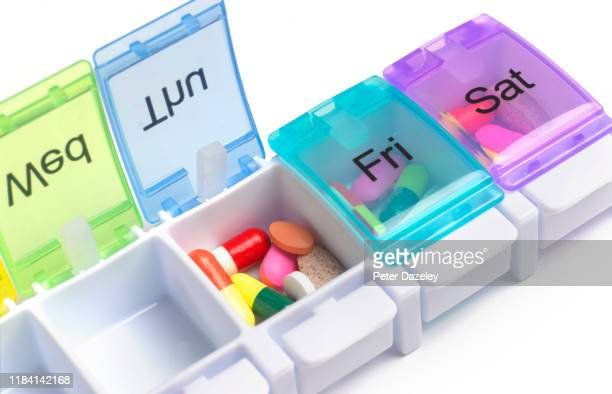 daily pill dispenser - medical insurance stock pictures, royalty-free photos & images