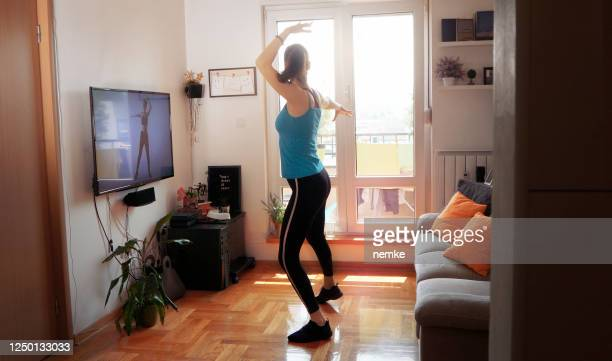 daily routine at home, woman doing fitness classes in front of tv - obedience training stock pictures, royalty-free photos & images