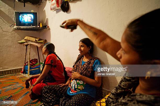 Daily routines for the surrogate mothers in the Mumbai ghetto include watching TV A clinic in Mumbai called Surrogacy India have rented a room in a...