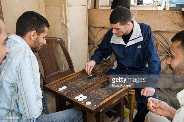 Daily scene in the middle east, Backgammon is one of the most popular games played at homes or in street cafes. Photo taken in Alexandria, Egypt.