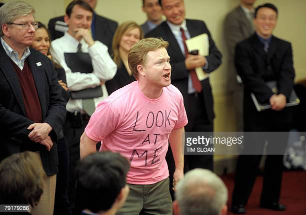 Daily Show writer Kevin Bleyer imitates a Code Pink demonstrator during a comedic mock debate and news conference about the issues at the center of...