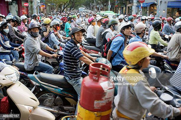 CONTENT] daily traffic jam of mostly motorcycles evening during rush hour in Ho Chi Minh City or Saigon