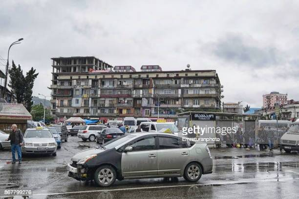 daily traffic on cahvchavadze street in batumi on a rainy autumn day. - emreturanphoto stock pictures, royalty-free photos & images