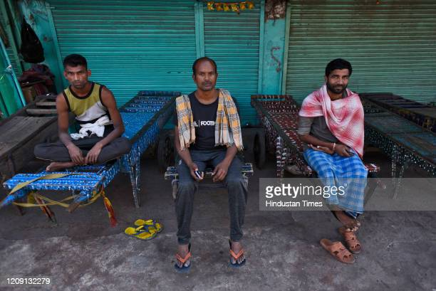 Daily wage workers seen on their hand carts on day eleven of the 21day nationwide lockdown to curb the spread of coronavirus at Sadar Bazar on April...