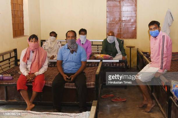 Daily wagers from Bangalore, stranded en route Madhepura, at a night shelter, on Day 2 of the three week nationwide lockdown to check the spread of...