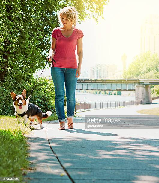Daily walks outside keep her dog happy and healthy