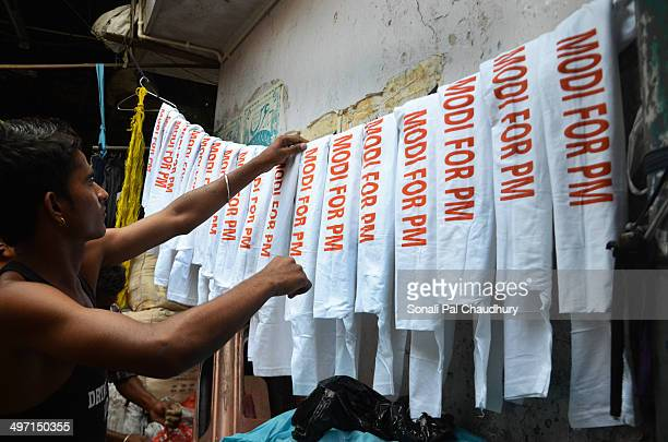 Daily worker making T-shirts for the Presidential election of India 2014 for the BJP supporters in Kolkata.