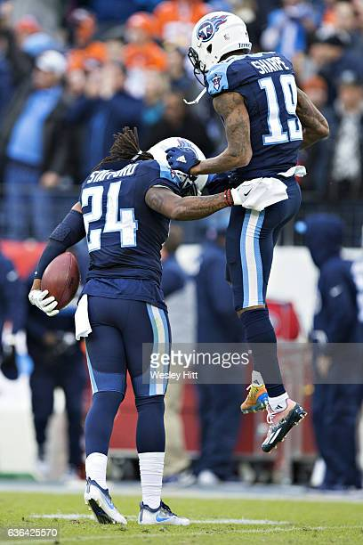 Daimion Stafford and Tajae Sharpe of the Tennessee Titans celebrate after a fumble recovery near the end of the game against the Denver Broncos at...