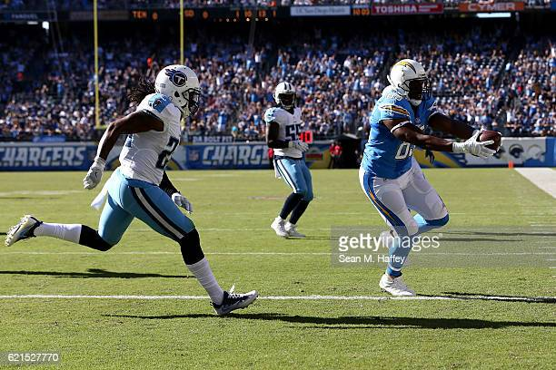 Daimion Stafford of the Tennessee Titans pursues Antonio Gates of the San Diego Chargers into the end zone as the Chargers score in the first half at...