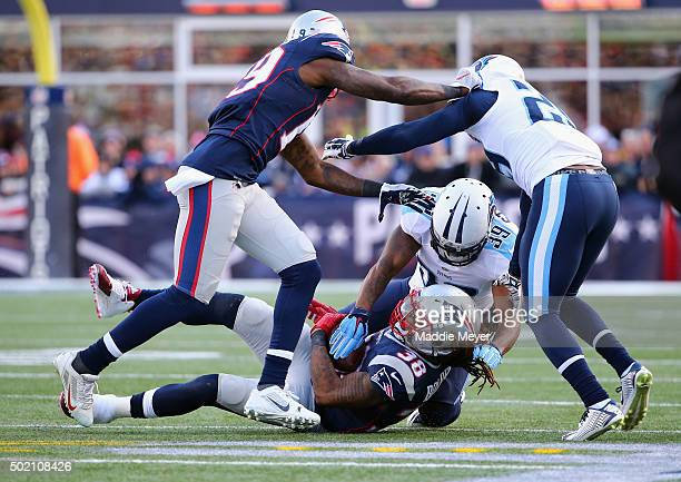 Daimion Stafford of the Tennessee Titans tackles Brandon Bolden of the New England Patriots during the first half of their game at Gillette Stadium...