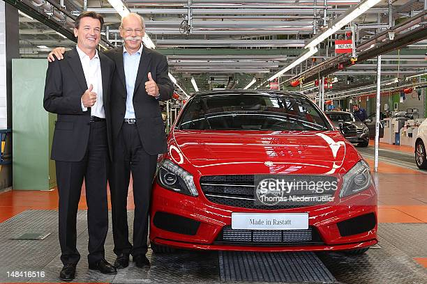 Daimler AG CEO Dieter Zetsche and Dr Wolfgang Bernhard Member of the Board of Management of Daimler AG pose for the media beside the new AClass...