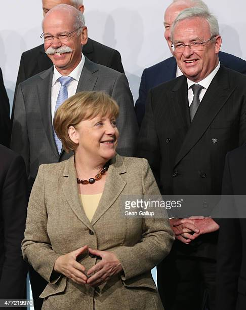 Daimler AG CEO Dieter Zetsche and Volkswagen Group CEO Martin Winterkorn look on as German Chancellor Angela Merkel arrives at the...