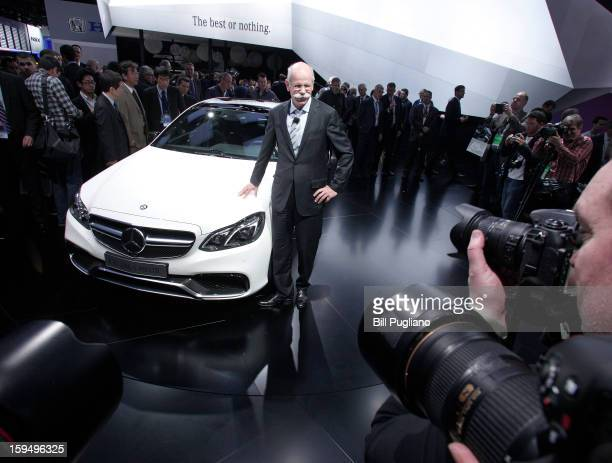 Daimler AG Chairman and CEO Dieter Zetsche poses with the new 2014 MercedesBenz E63 AMG at its world debut at the 2013 North American International...