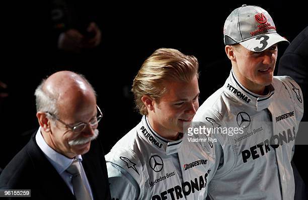Daimler AG chairman Dieter Zetsche Nico Rosberg and Michael Schumacher of Germany and Mercedes GP pose for a photo during the Mercedes GP Petronas...