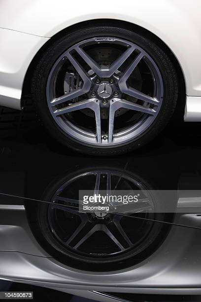 A Daimler AG Mercedes Benz star is seen the hubcap of an automobile on display on the second press day of the Paris Motor Show in Paris France on...