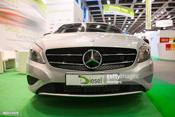 A Daimler AG MercedesBenz AClass automobile stands on the Neste Oil Oyj biofuel diesel trade stand at the Green Week agricultural fair at the Messe...