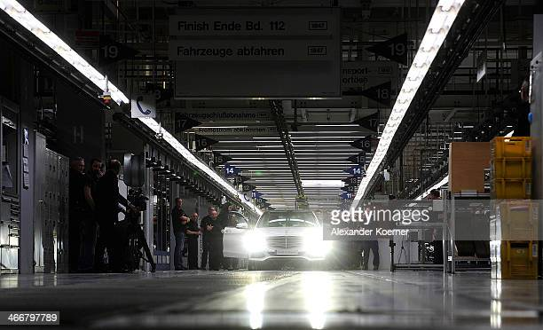 Daimler AG MercedesBenz CClass automobile is pictured leaving the assembly line at the MercedesBenz plant of Daimler AG on February 04 2014 in Bremen...