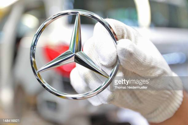 Daimler AG MercedesBenz emblems is displayed for the photographer prior to attachment to the new AClass MercedesBenz passenger car at the...