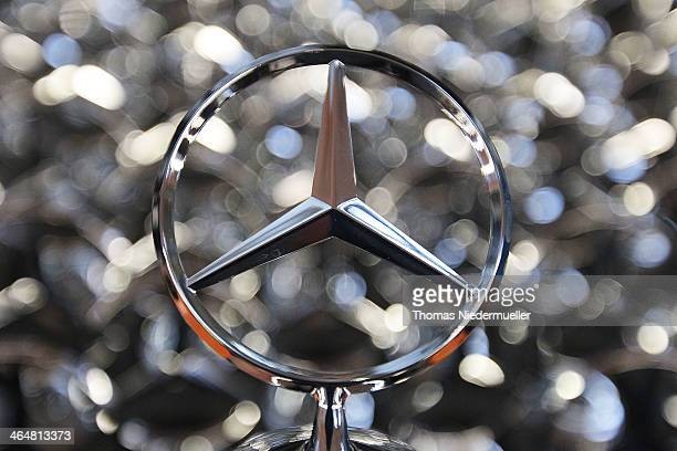 Daimler AG MercedesBenz emblems stand ready for attachment to SClass sedans on the assembly line at the MercedesBenz plant of Daimler AG on January...