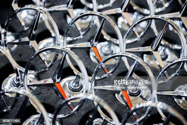 Daimler AG MercedesBenz emblems stand ready for attachment to SClass sedans on the assembly line at the MercedesBenz plant on January 24 2018 in...