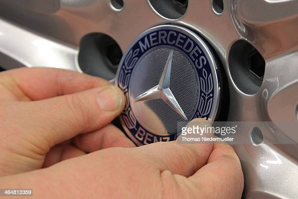 Daimler AG MercedesBenz logo sits on the alloy wheel of a Daimler AG MercedesBenz SClass sedans on the assembly line at the MercedesBenz plant of...