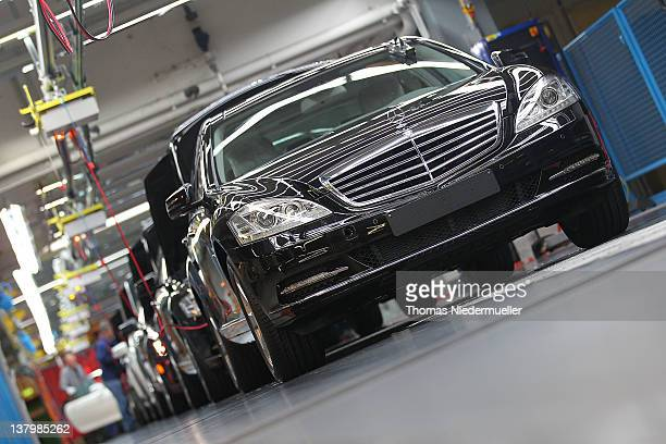 Daimler AG MercedesBenz Sclass automobiles travel along the production line inside the company's factory on January 30 2012 in Sindelfingen Germany