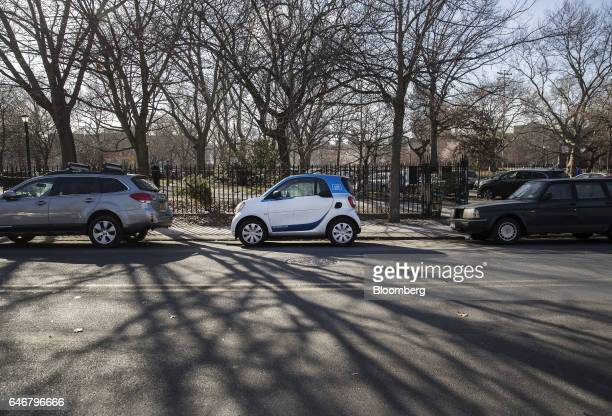 A Daimler AG Smart ForTwo Car2Go carsharing automobile sits parked on a street in the Williamsburg neighborhood in the Brooklyn borough of New York...