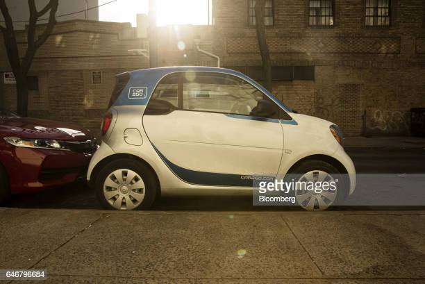 A Daimler AG Smart ForTwo Car2Go carsharing automobile sits parked on a street in the Greenpoint neighborhood in the Brooklyn borough of New York US...