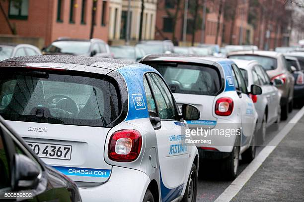 Daimler AG Smart ForTwo Car2Go carsharing automobiles sit parked on a street in Berlin Germany on Wednesday Dec 9 2015 Daimler will review its...