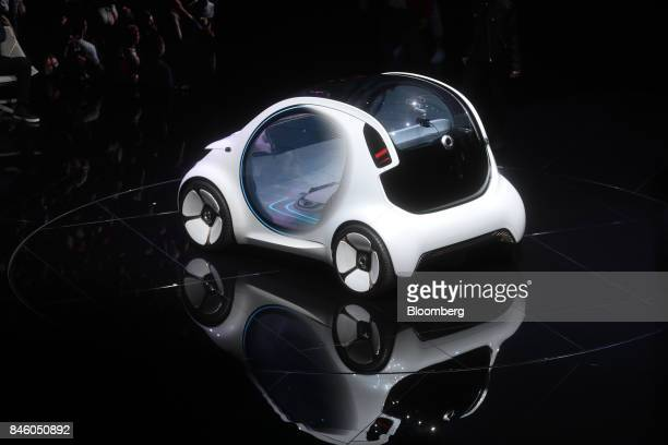 A Daimler AG Smart Vision EQ fortwo electric autonomous selfdriving concept automobile sits on stage during the first media preview day of the IAA...
