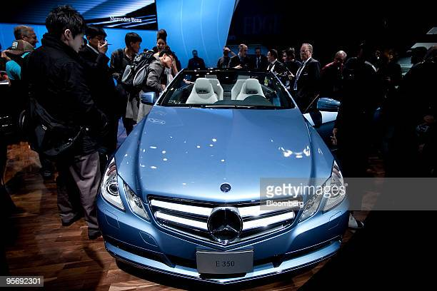 Daimler AG's MercedesBenz E350 convertible sits on display following its unveiling on day one of the 2010 North American International Auto Show in...