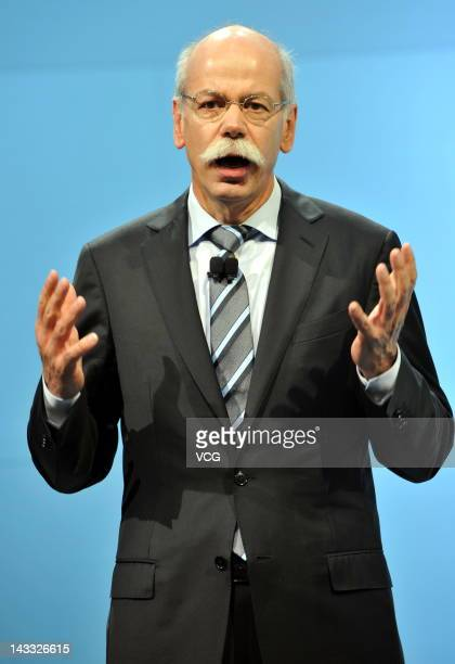 Daimler CEO Dieter Zetsche attends the Denza electric car unveiling during the 2012 Beijing International Automotive Exhibition at China...