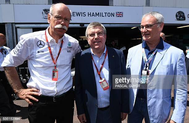 Daimler CEO Dieter Zetsche IOC president Thomas Bach and Leicester manager Claudio Ranieri pose for a photograph during the qualifying session at the...