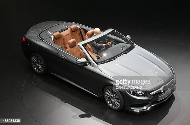 Daimler CEO Dieter Zetsche presents the MercedesBenz Sclass cabriolet at the 66th IAA auto show in Frankfurt am Main western Germany on September 15...